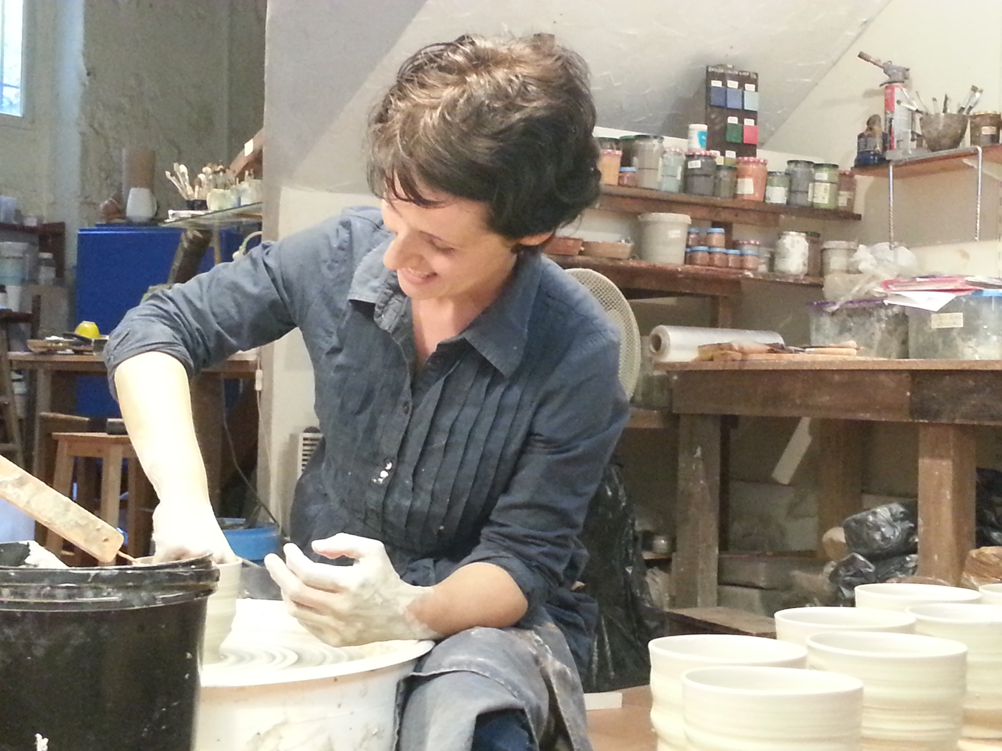 Cecile Cayrol making. Mugs in her pottery studio, La Main Qui Pense, Arles, France